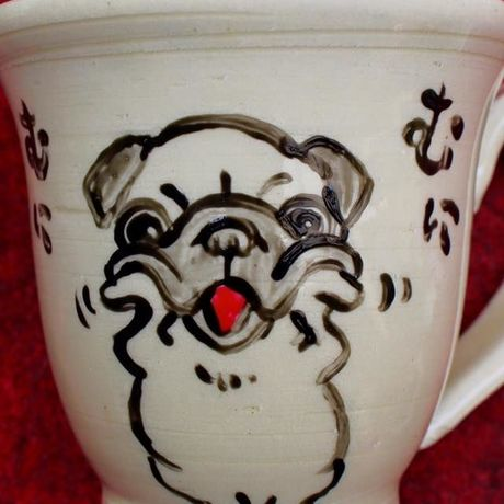 Pug of hand-painted pottery
