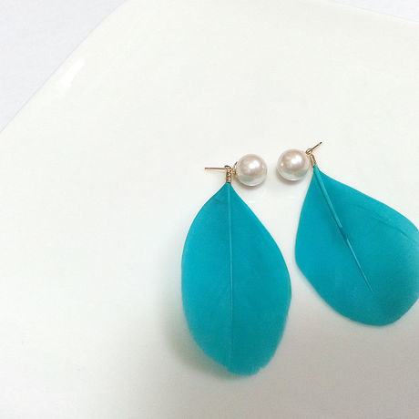 feather designed earrings